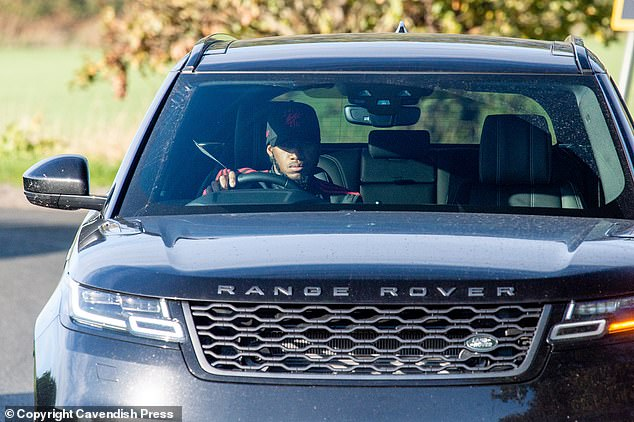 Manchester United midfielder Fred travels to the Carrington training ground on Friday morning