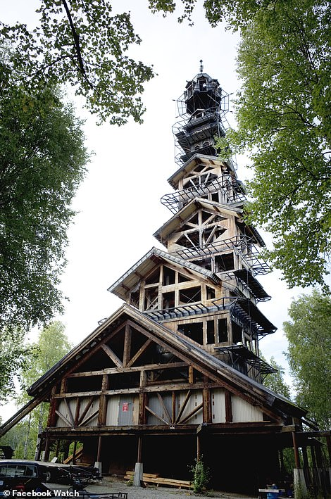 Tucked away in the stunning Alaskan wilderness, a stack of wooden houses is stacked on top of each other by lawyer Philip