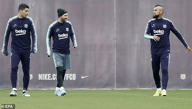 Suarez and Messi watched Chilean midfielder Arturo Vidal make a joke in training