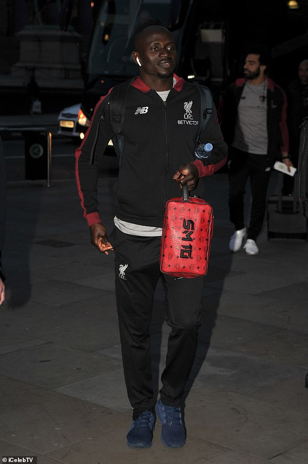 Sadio Mane relaxed as he strolled into the wardrobes with his custom made toiletry bag
