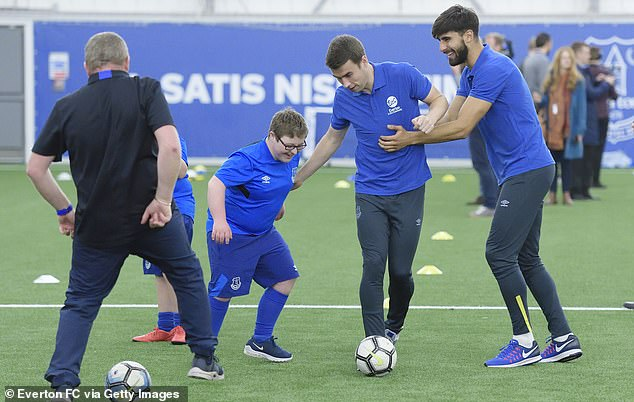 Seamus Coleman and Andre Gomes play football at the charity event at Finch Farm