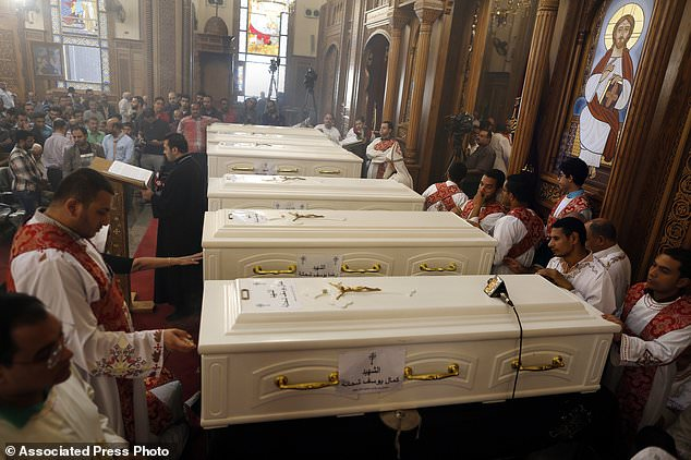 Coffins of the killed Coptic Christians are seen during their funeral service in the Church of the Great Martyr Prince Tadros in Minya, Egypt, Saturday, November 3, 2018. Optical Christians in the Egyptian city of Minya were preparing to bury their dead the following day Militants stormed three buses of Christian pilgrims on their way to a remote desert monastery, killing seven and wounding 19th (AP Photo / Amr Nabil)