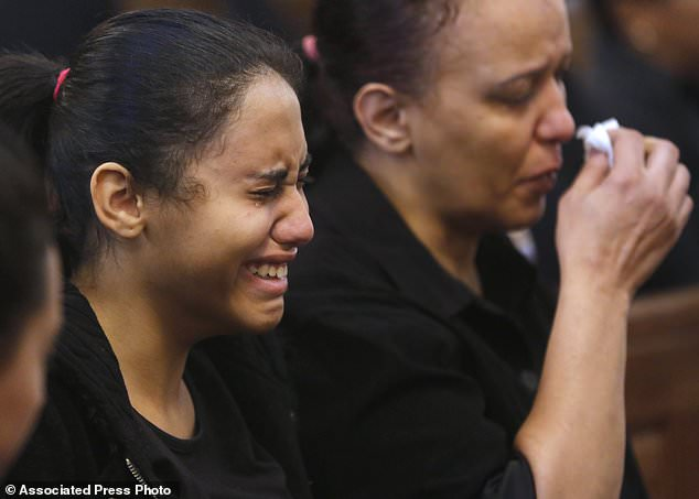 Relatives of the killed Coptic Christians grieve during their funeral in the Church of the Great Martyr Prince Tadros in Minya (Egypt) on Saturday, November 3, 2018. Coptic Christians in the Egyptian city of Minya were preparing to bury their dead one day After the militants attacked three buses with Christian pilgrims to a remote desert monastery. (AP Photo / Amr Nabil)