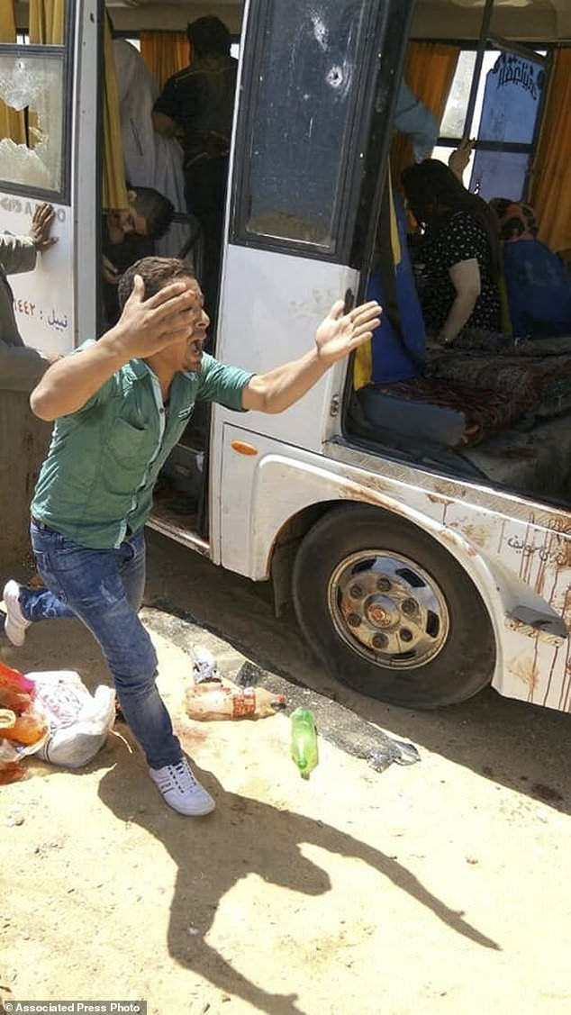 A man is shouting beside a bus carrying Coptic Christians who were attacked in Cairo on Friday, November 2, 2018. Islamic militants raided a bus that killed Christian pilgrims on their way to death on the way to a remote desert monastery south of the Egyptian capital. The Home Office said at least seven and wounded a dozen more (Egyptian Coptic Orthodox Church via AP).