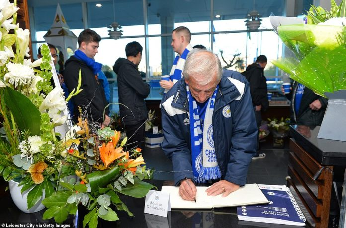 A Leicester fan signs the book of condolence for Srivaddhanaprabha before traveling to South Wales for Saturday's game