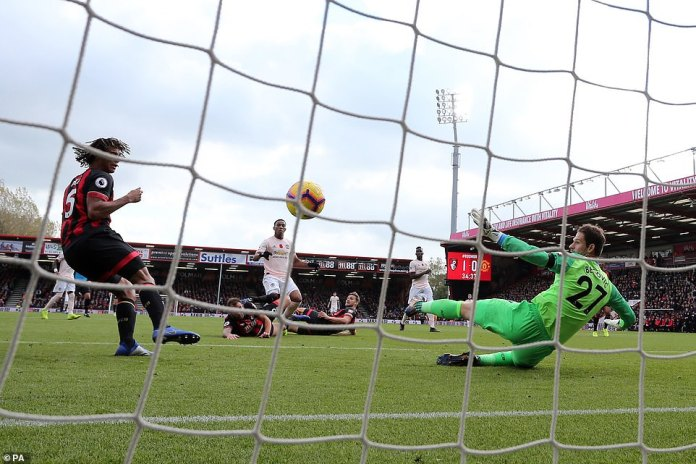 Goalkeeper Asmir Begovic of Bournemouth dives to the right as the ball turns towards the back of the Bournemouth net