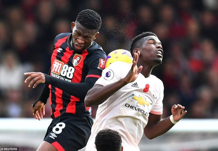 Jefferson Lerma of Bournemouth meets Pogba of Manchester United as they fight for a ball of air
