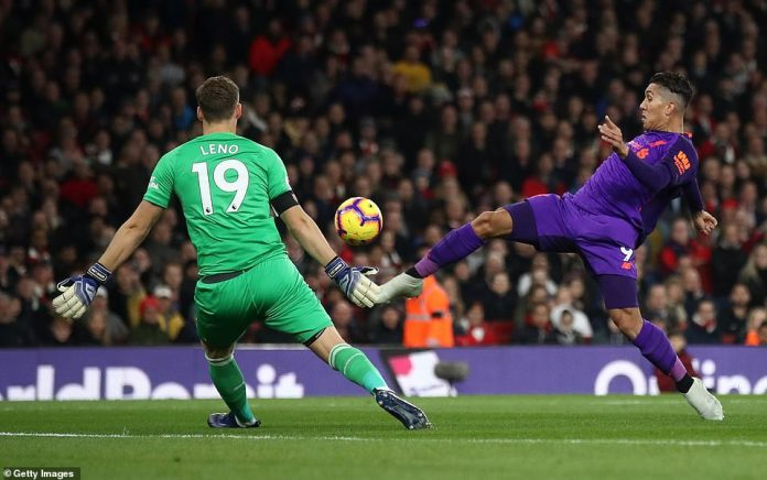 Roberto Firmino (on the right) lifts the ball over Bernd Leno and only on the post, so Mane (not pictured) scores the rebound