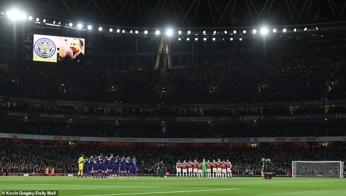 Both groups of players attend a minute's silence for Leicester's late chairman Vichai Srivaddhanaprabha and the four others who died in the helicopter crash last Saturday