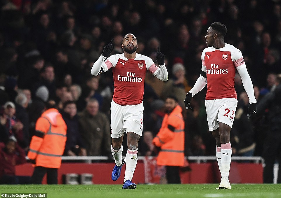 Alexandre Lacazette points to the sky after scoring a brilliant equalizer on Saturday in the second round of Arsenal against Liverpool