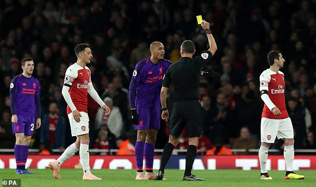 Fabinho was booked out in the first half and was lucky enough to miss a red spot for Mesut Ozil