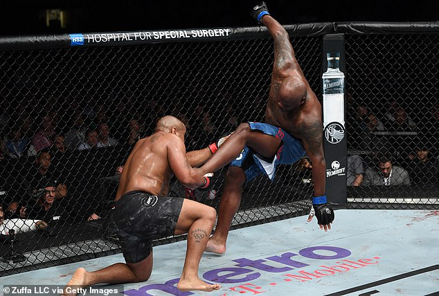 Lewis tries to counter the kick, which proved futile when he lost in the second round