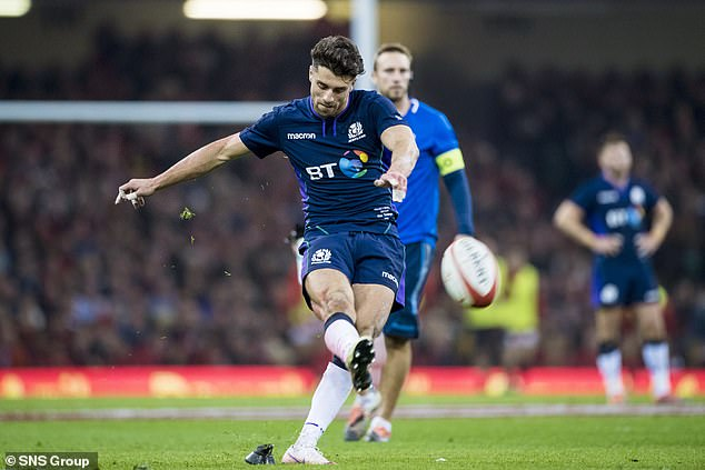 It's a tough afternoon for Scotland's playmaker Adam Hastings after he was squeezed