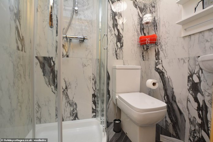 A stay at the property costs £ 14 per person per night. Pictured is the modern shower and toilet room in the truck