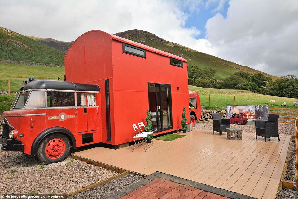 The Red Rescue Retreat in the heart of the Lake District, near Keswick, a former fire truck that has been converted into a vacation rental. It is not clear why there is a picture of a burning house next to the terrace