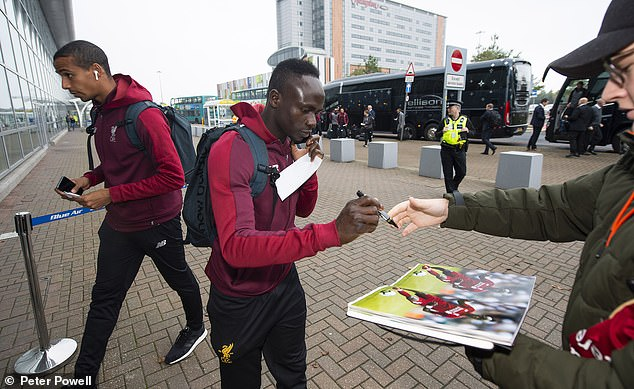 Sadio Mane signs his autograph for a trailer as he is greeted at John Lennon Airport