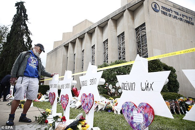 """A man takes a moment at each of the Star of David memorials with the names of the eleven people who were killed two days after a mass shooting in Pittsburgh in the """"Tree of Life"""" synagogue"""