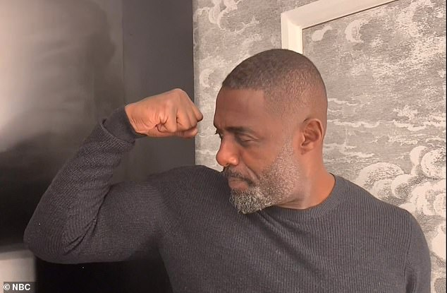 """Funny flex, but ok: Idris showed his big biceps when he was announced when he declared he was the """"sexiest man in the world""""."""