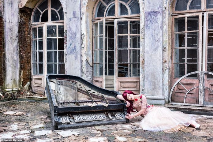 Jade lies in front of a dilapidated palace in central Poland in a shot captured last spring in front of a smashed piano
