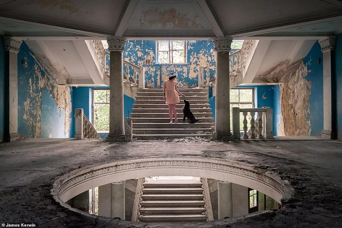 Jade caresses a stray dog ​​in an empty former sanatorium in Georgia. The animal had approached her during the shoot