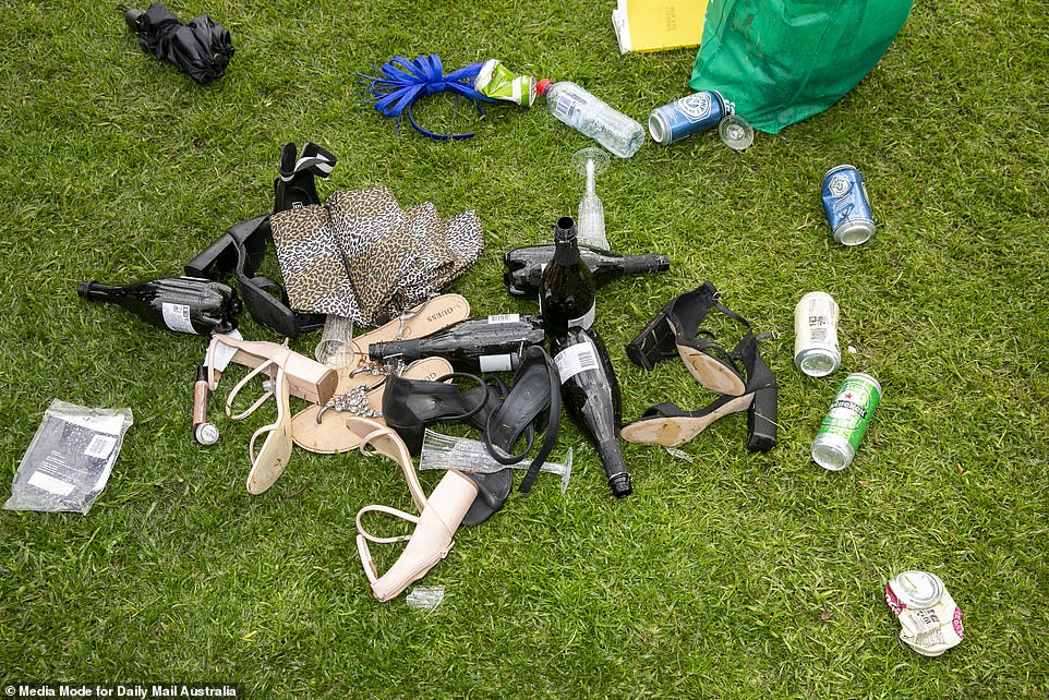 Shoes proved to be too much for some by the end of the race. The pile of discarded items included bottles, heels and umbrellas