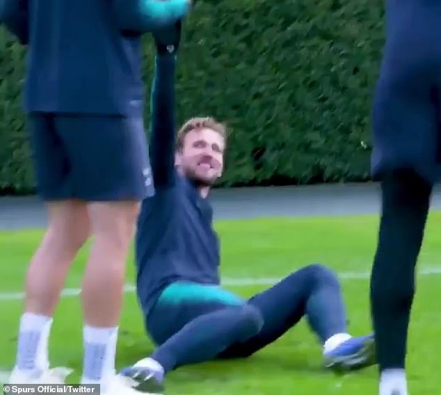 Kane then falls to the floor after Fernando Llorente nutmegs him for the second time