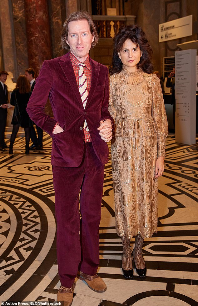 Bold: Filmmaker Wes, 49, looked suave in acorduroy suit while illustrator Juman, 43, cut a sophisticated figure in a gold two-piece