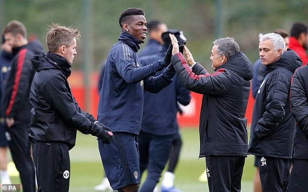 Paul Pogba High Five assistant coach Ricardo Formosino as Manchester United coach