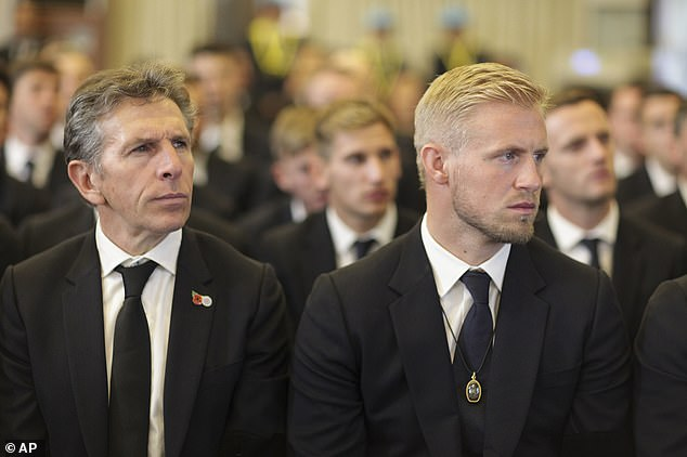 Leicester City manager Claude Puel (left) looks sombre as he sits with goalkeeper Kasper Schmeichel during the funeral