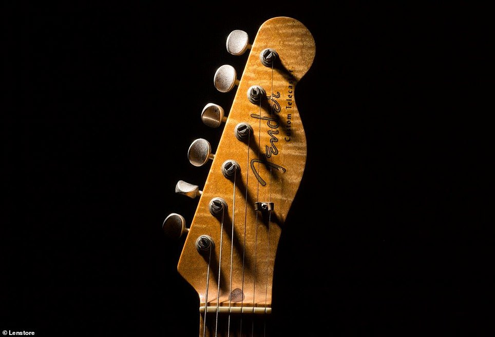 Ring flashes with flash tubes arranged in a circle around the front of the lens can help light objects from close range. Pictured is a guitar