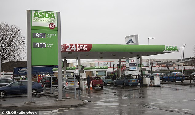 Asda, Morrisons, Sainsbury's and Tesco cut their prices after fuel retailers were accused of not passing on savings from lower wholesale costs. Pictured: An Asda station in south-east London
