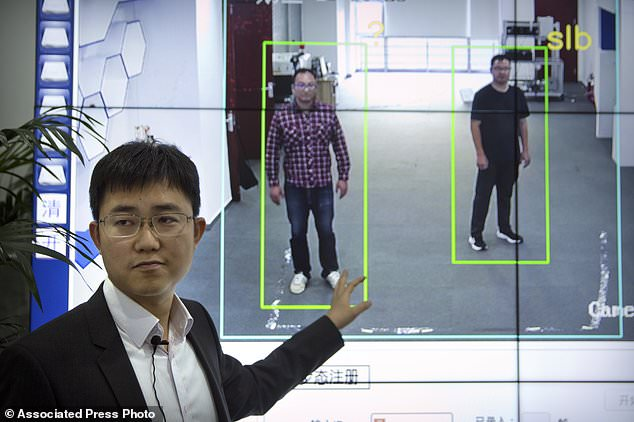 """China is using a new monitoring tool: a """"gait detection software"""" that uses people's body shape and how they go to identify them, even when their faces are hidden. Pictured is Huang Yongzhen, CEO of Watrix, the company behind the controversial technology"""