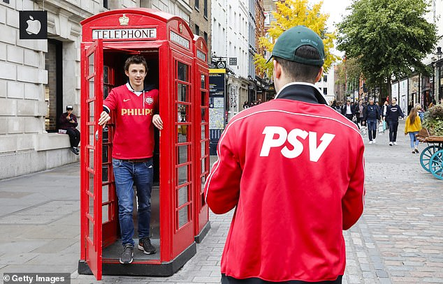 A trailer jumped into a traditional red telephone booth when his friend took the picture
