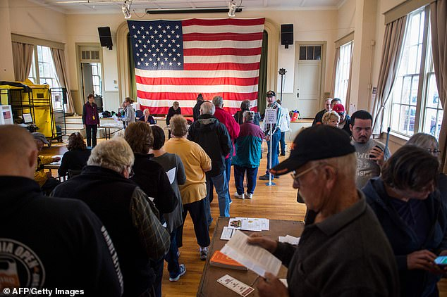 Voters wait to get a ballot at a polling station during the mid-term elections at the Old Stone School in Hillsboro, Virginia