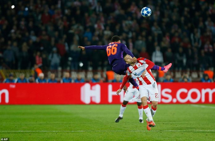Trent Alexander-Arnold flies in the air as he competes with Milan Rodic in a full-fledged challenge at the Rajko Mitic Stadium