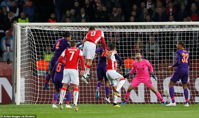Pavkov towered over the Liverpool defenders and steered his head beyond Alisson to the bottom corner