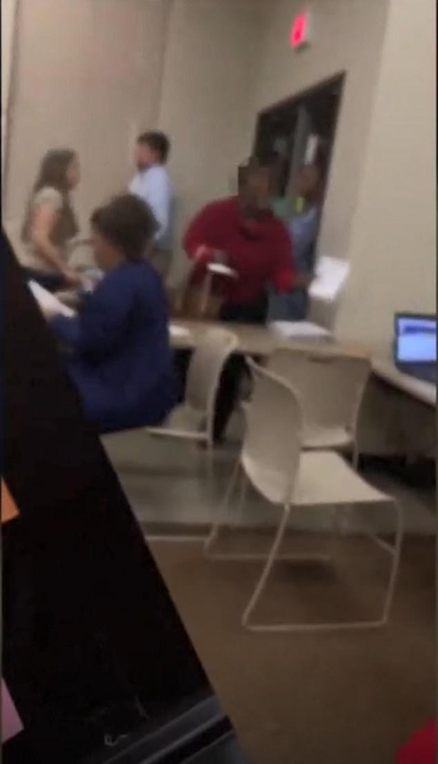 The woman was seen leaving the polling site after Guzman threatened to call the police