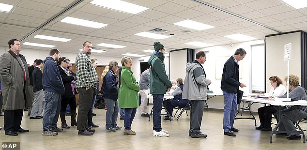 Voters cast their ballots in the midterm elections at Prince of Peace Lutheran Church in Appleton, Wisconsin