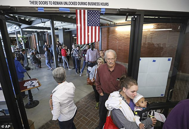 People stand in line to vote Tuesday, Nov. 6, 2018, in Salt Lake City