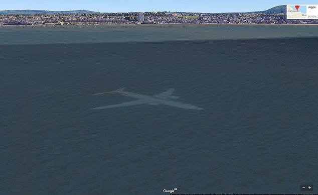 At first glance, the Google Earth image looks like a plane underwater off the coast of Scotland