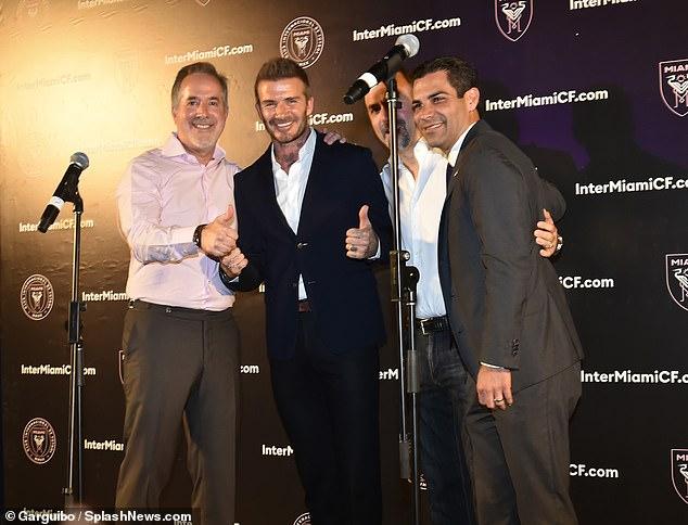 Jorge Mas (left) celebrates the result of the vote in Miami