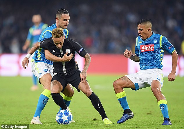 Neymar tries to escape from Napoli during the meeting of group C of Nikola Maksimovic