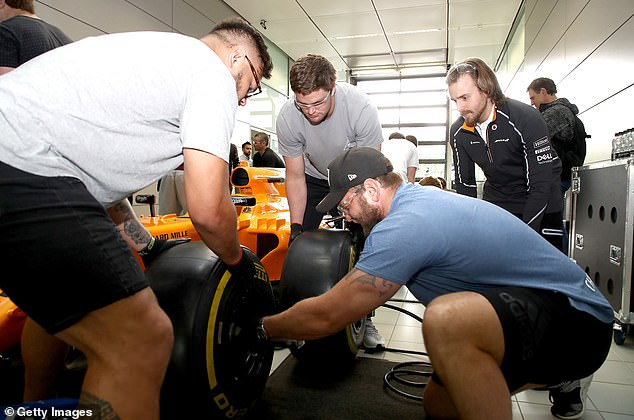 F1 mechanics need less than three seconds to build a tire at scheduled pit stops