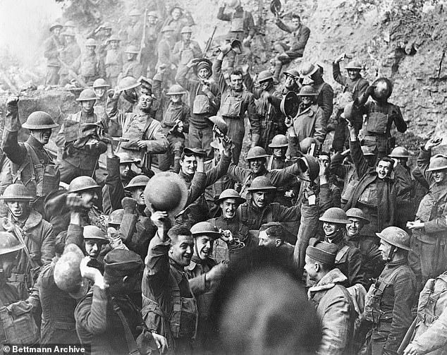 News of the end of World War I is joyfully received by the men of the 64th Regiment Infantry, 7th Division in Min de Jaueny, Moselle, France on November 11, 1918
