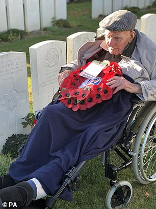 Mr Freer laying a wreath of his father's grave