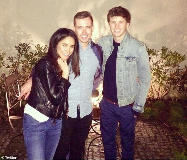 A photograph of Meghan partying in Istanbul with Eddie Redmayne has resurfaced online. It shows the smiling pair withLondon-based photographer Jason Bailey (centre)
