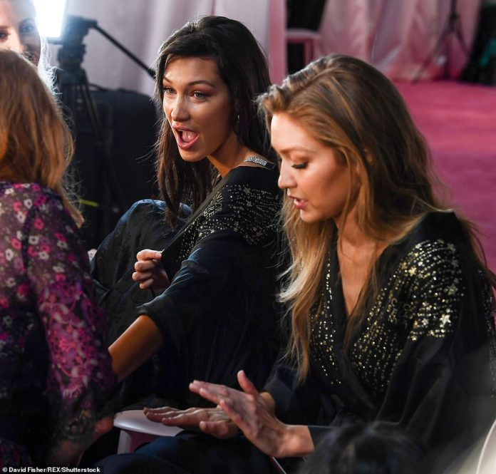 Sister act: Gigi and Bella Hadid sat side by side as they got ready for the show
