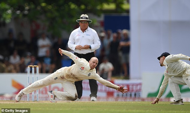 Leach dives his entire length to deploy the ball from his bowl as England's victory in Galle