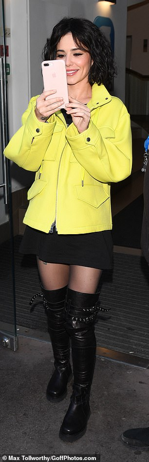 Capturing the moment: Cheryl took pictures of her fans when she left the studios after her interview