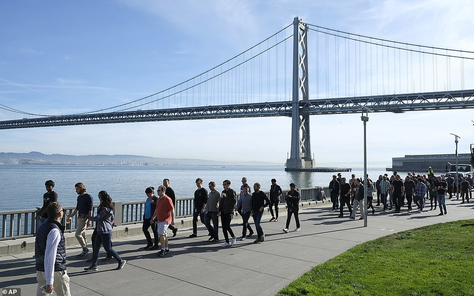 Google employees march along the Embarcadero in San Francisco on Thursday